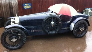 Don't forget your umbrella! Car at Pre-War Prescott waits for the sunshine.