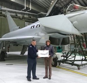 Sgt Stuart Smylie, presenting me with a print of the Typhoon behind me, signed by crew of II (AC) Squadron.